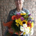 Beautiful Lady with Colorful Hand Tied Bouquet